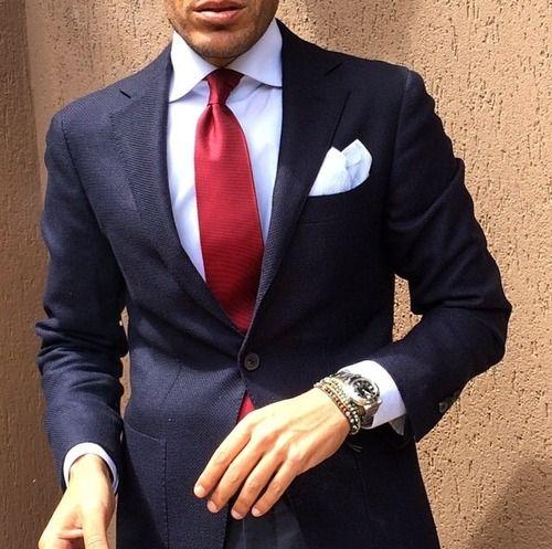 navy suit white shirt bright red tie white pocket