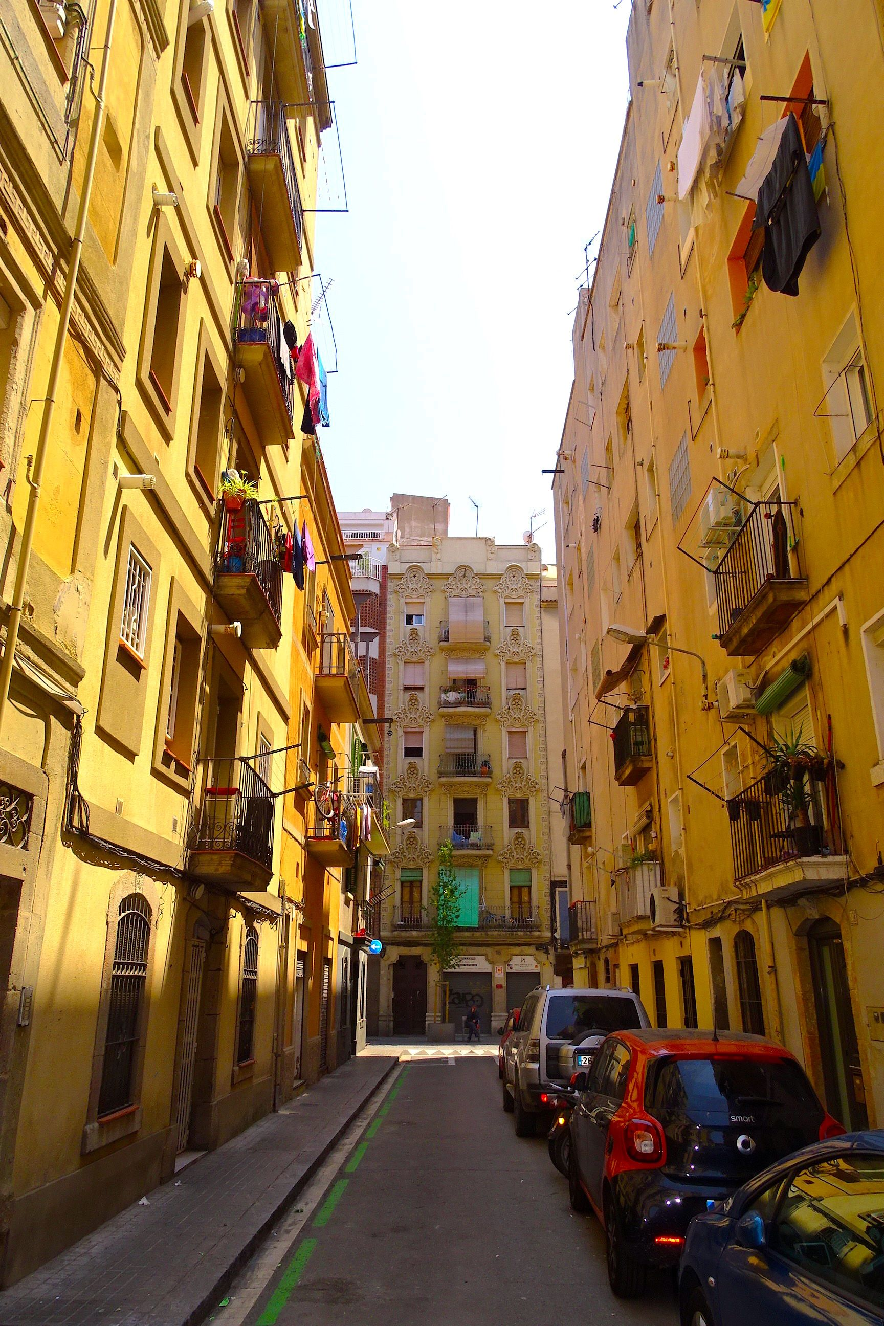 Love Strolling The Streets Of Barcelona There Is So Much Color And Style A Quiet Day In Barcelona Is Pictured Her Spain Tour Visit Barcelona Barcelona Travel