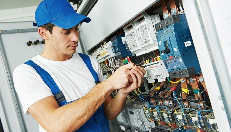 Working With A Commercial Electrician With Images Commercial Electrician Electrician Electricity
