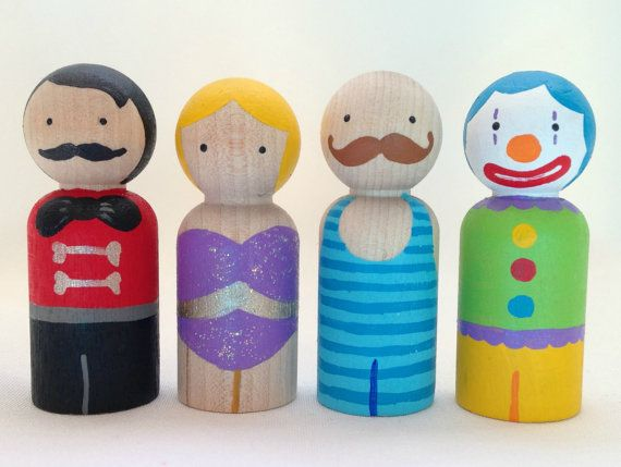 The Circus Collection - Ringmaster, Trapeze Artist, Strongman, and Clown Peg Doll Set