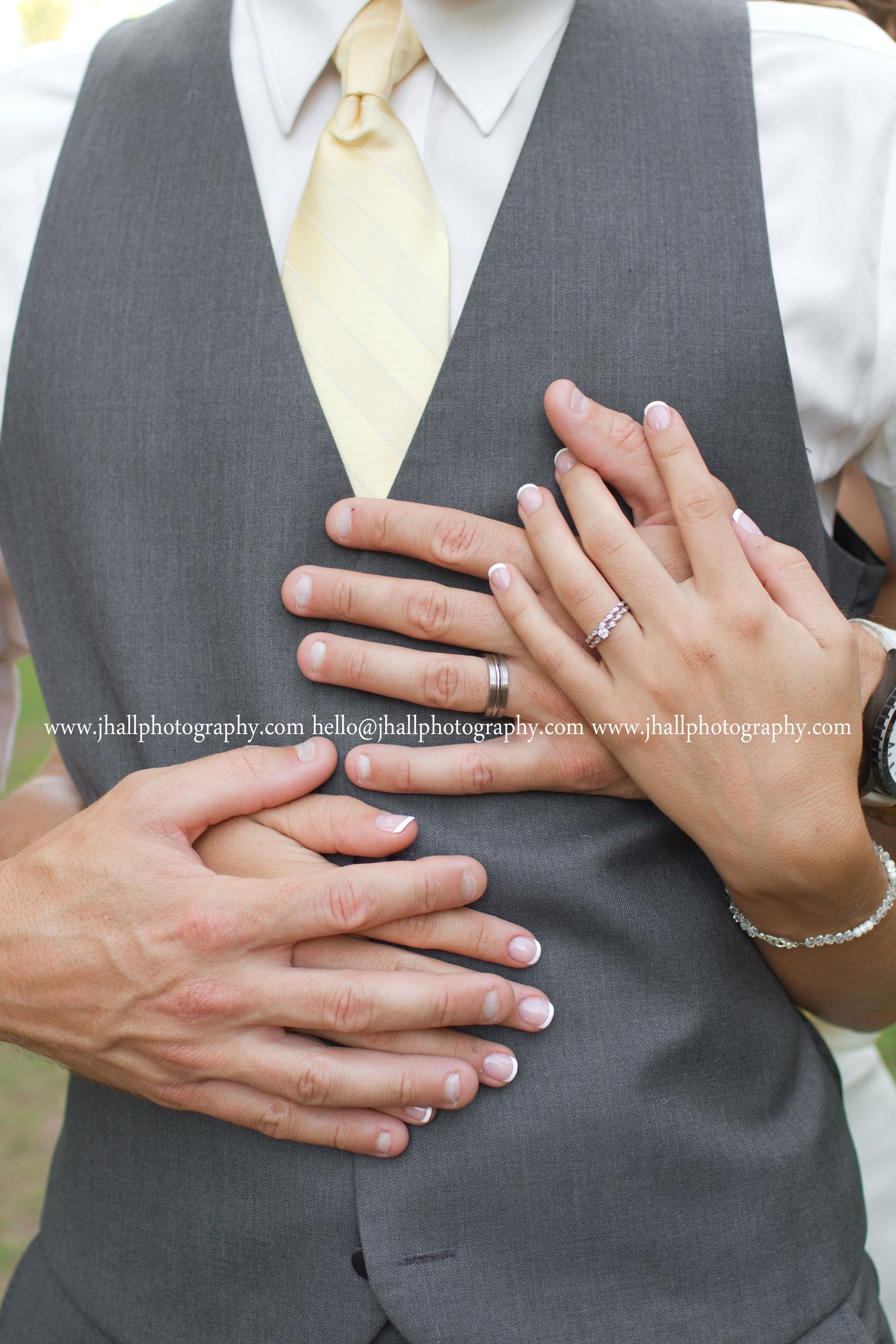 bride and groom ring shot wedding rings holding hands wedding