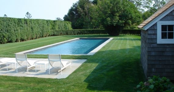 Pool surrounded by grass and minimal concrete the best for Pool design hamptons