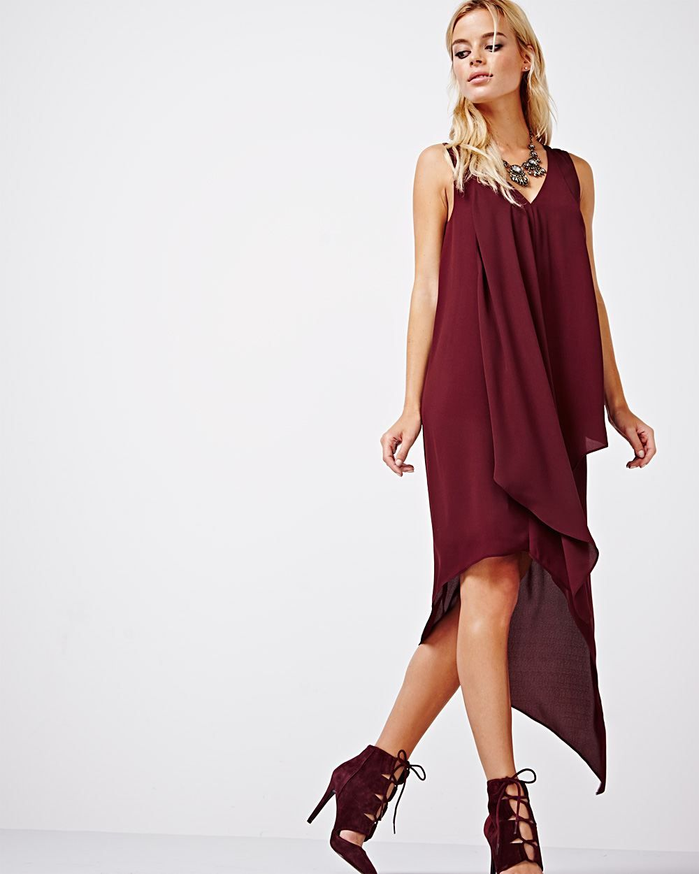 79b4dd114d This silky high-low maxi dress will have you looking polished morning to  night. Wear with a pair of strappy sandals for a sexy summer look.