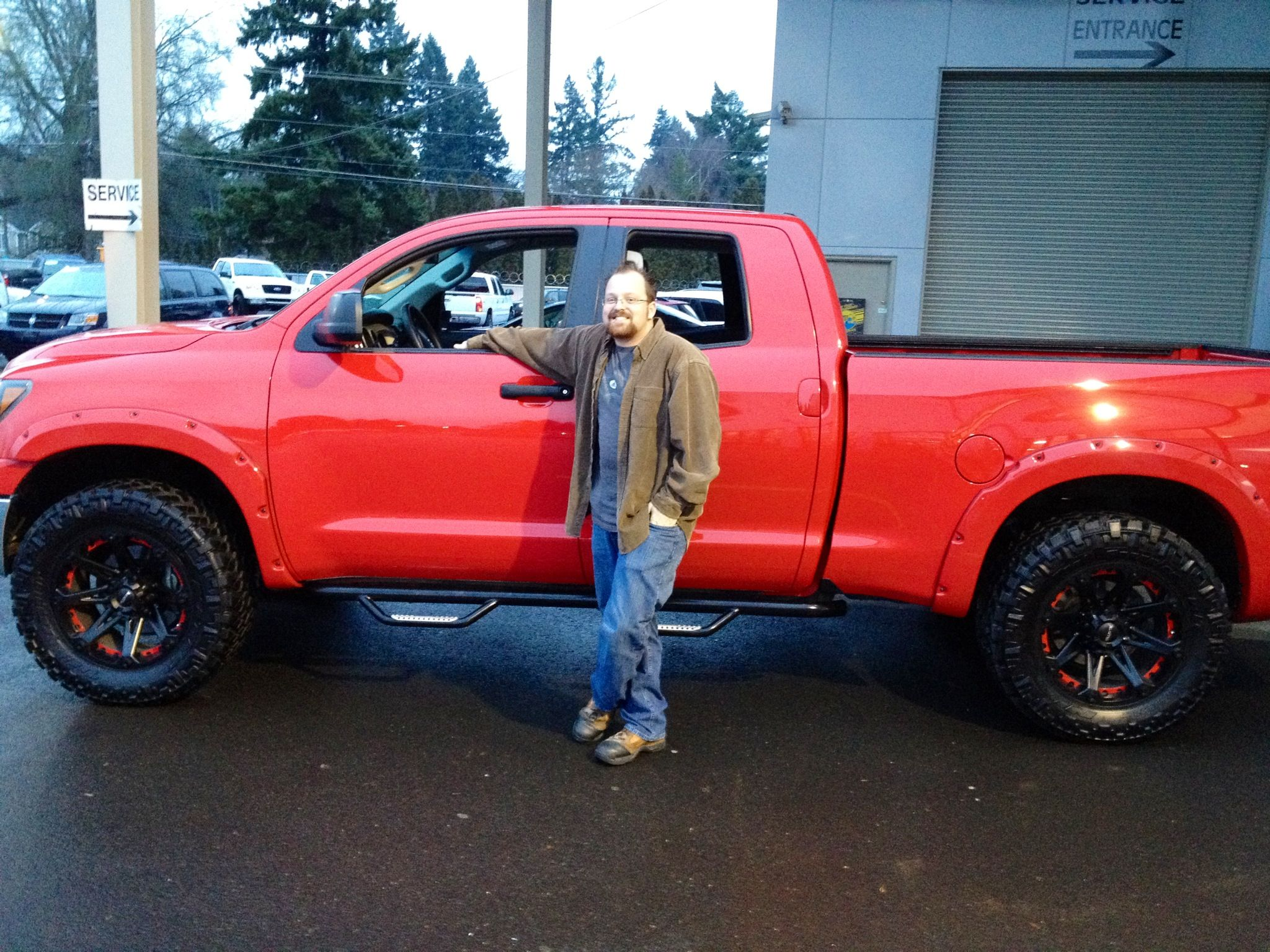 Red Toyota Tundra with black wheels!!!! Drool!!! (but swap out the cheesy running boards for black ones)
