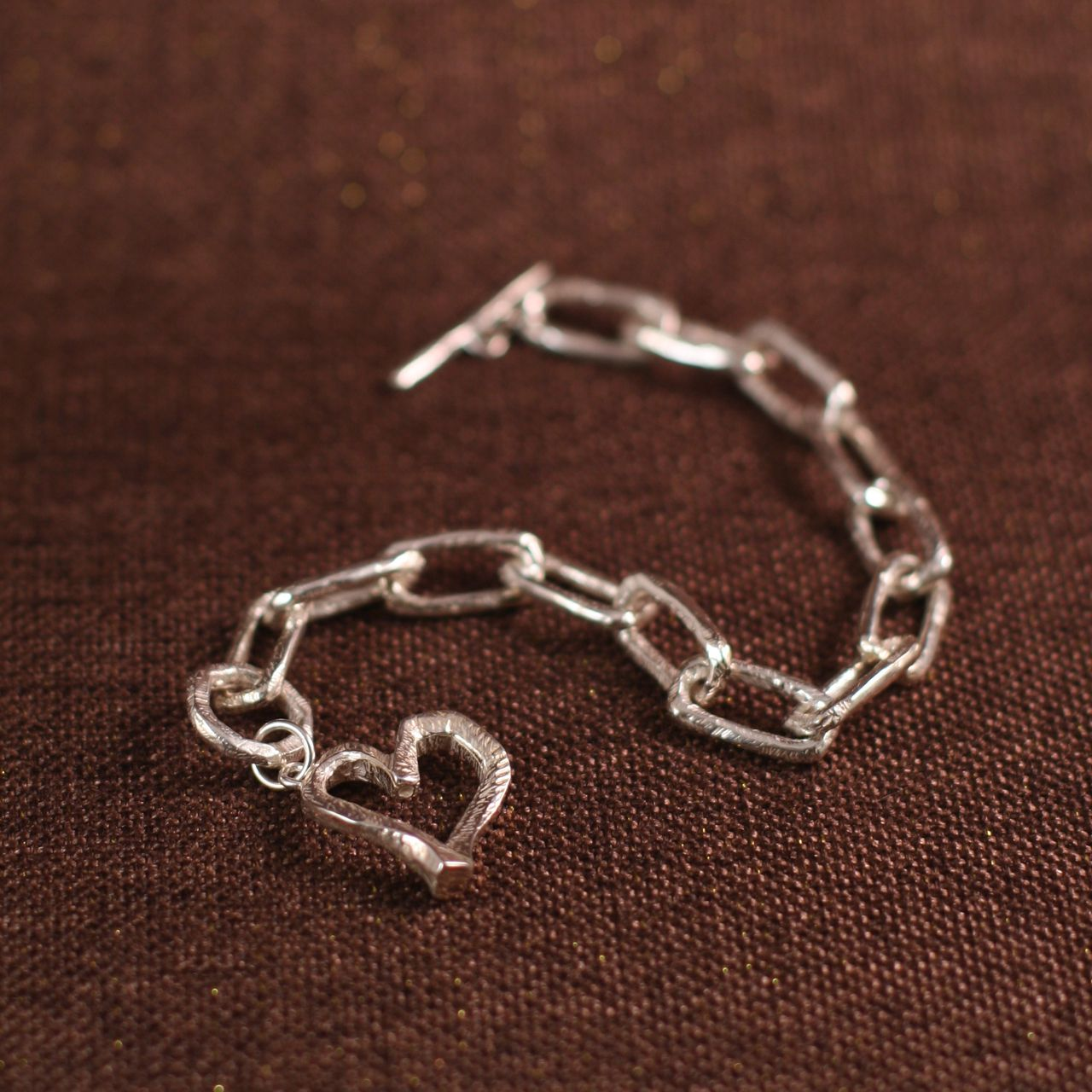 Janet sterling silver design rough around the edges heart bracelet