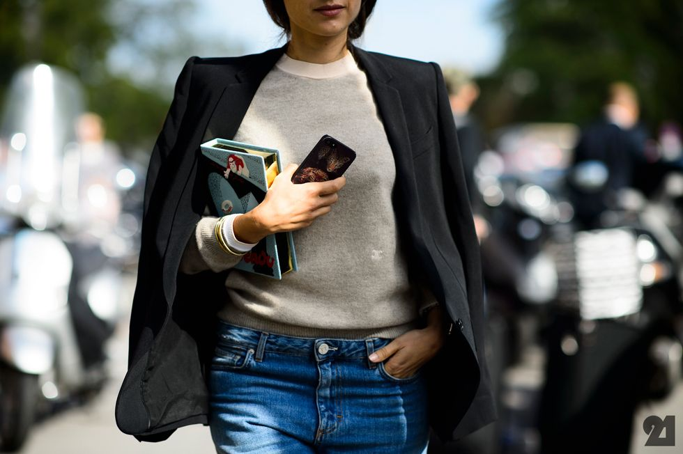 Woman with an Olympia Le Tan book clutch
