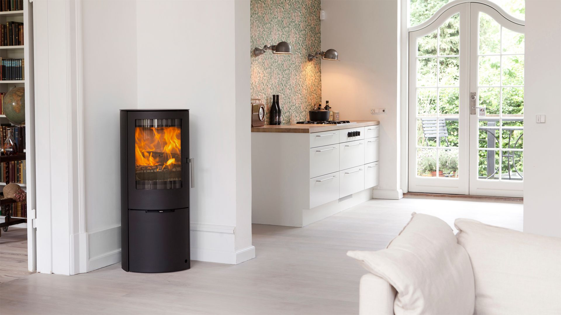 The Mido is a tall and slim stove that has a large curved glass ...