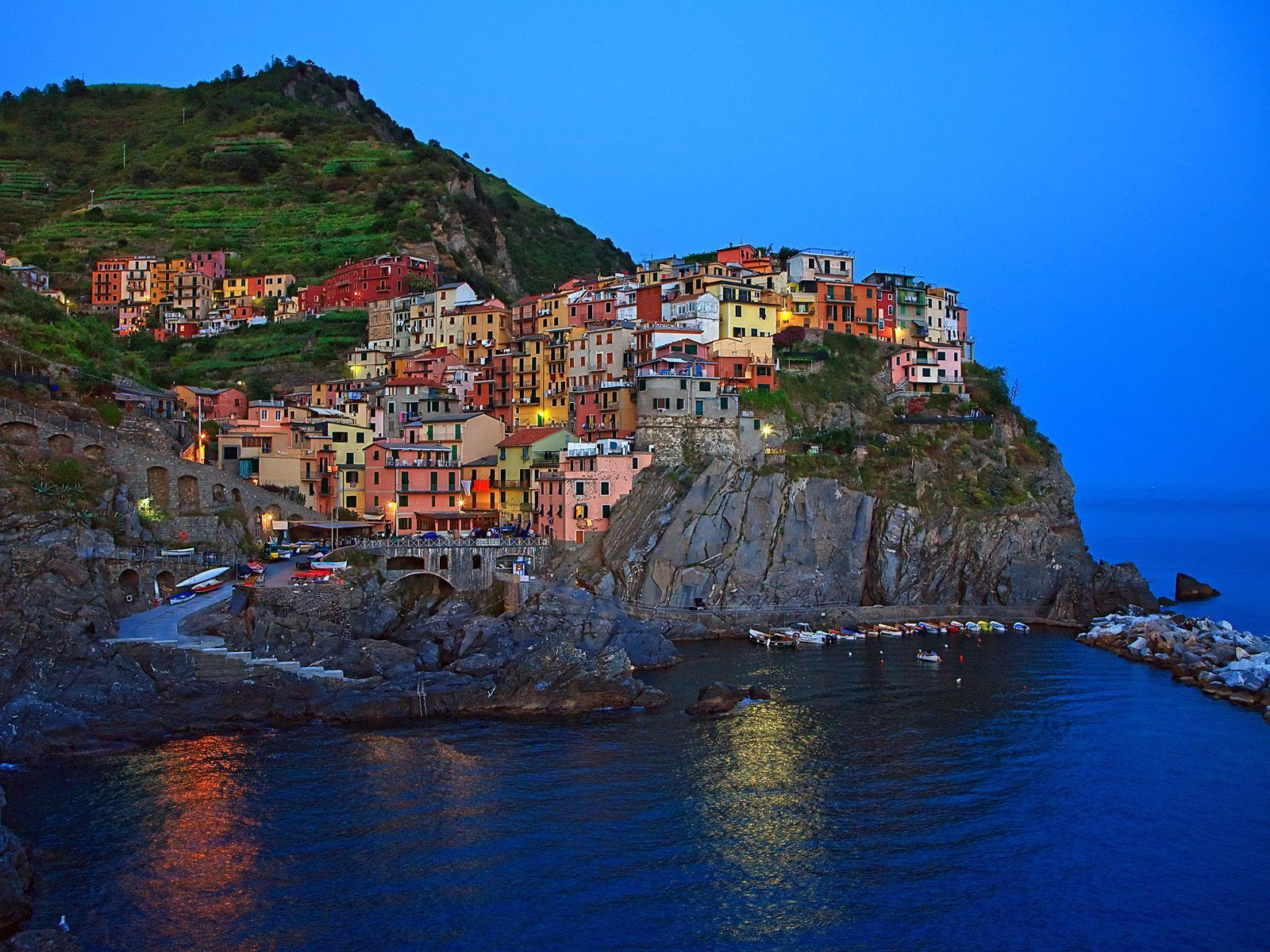 Cinque Terre is a marvelous union of five Italian Riviera villages sloping  down in steep banks