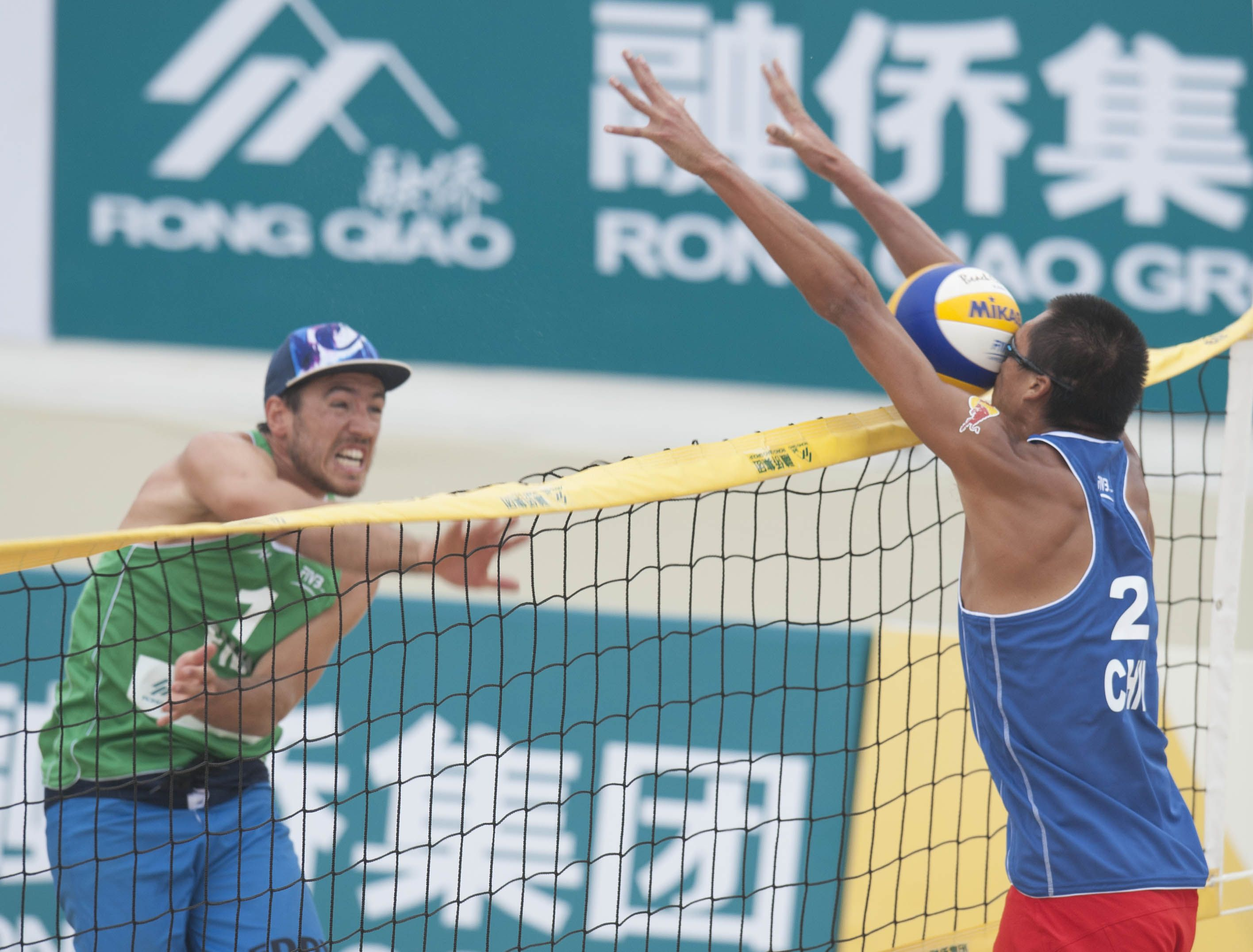 The Ball From France S Edouard Rowlandson Hits The Face Of Peng Gao From China At The Fivb Beach Volleyball F Fivb Beach Volleyball Beach Volleyball Volleyball