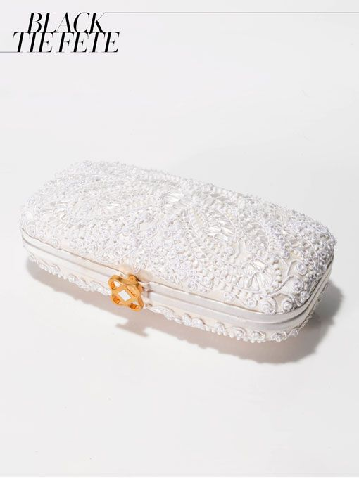 """Brides.com: 12 Stylish Wedding Details from Vogue's Annual Wedding Guide. The Bag. """"Goa"""" embroidered clutch in ivory, $1,450, Oscar de la Renta  See more wedding clutches."""