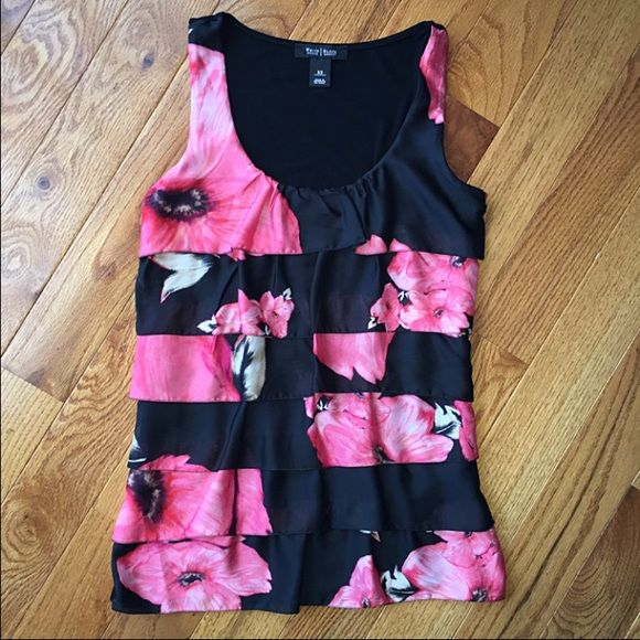 WHBM Pink Black Floral Ruffle Tiered Top Blouse Hi loves! Up for sale is this beautiful pink & black floral ruffle blouse from White House Black Market. This blouse cost $88. My mom bought it for herself, ripped the tag off and never wore it. It's too small for her. It's a size XS.  ⭐️Posted on Ⓜ️ercari for cheaper⭐️  NO TRADES PLEASE. Thank you for your interest :) xox White House Black Market Tops Blouses