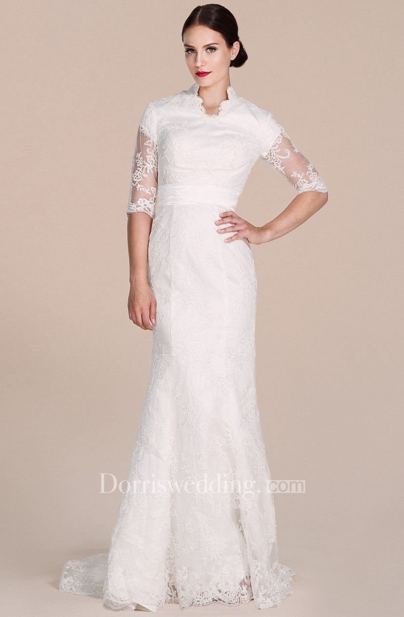 Halfsleeved lace gown with illusion sleeves in wedding
