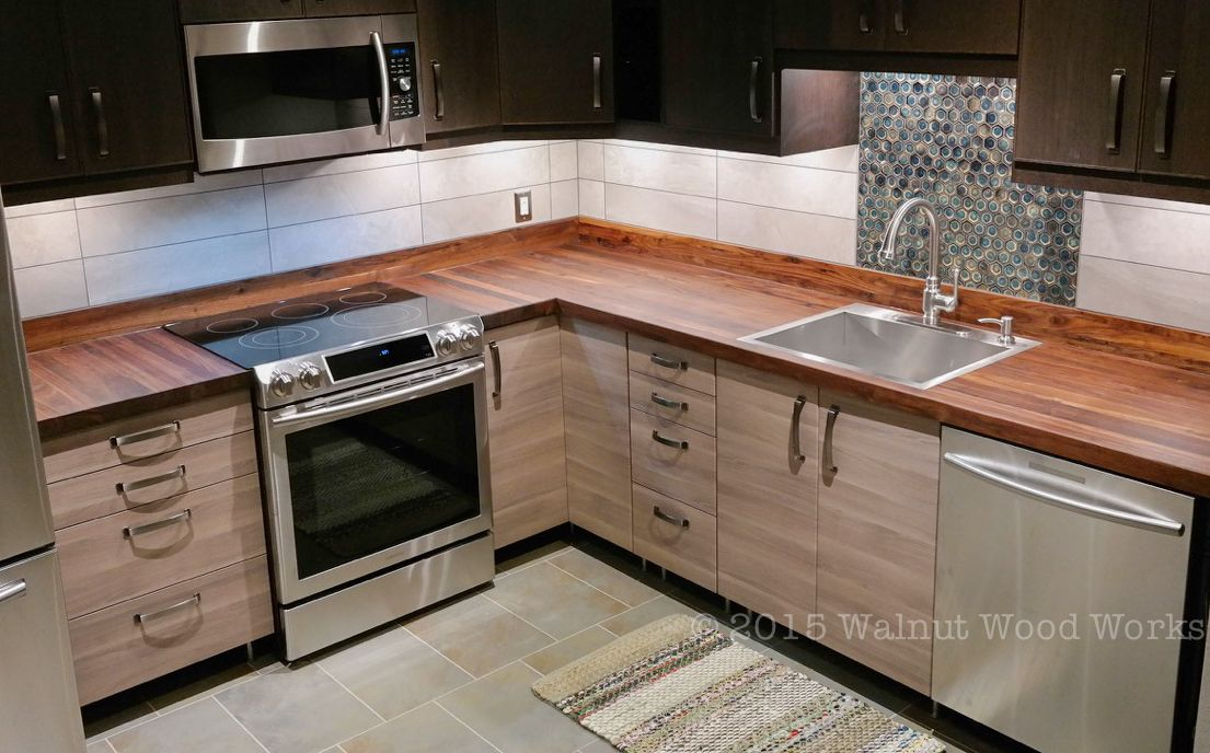 Modern Kitchen With Walnut Butcherblock Countertop And Backsplash