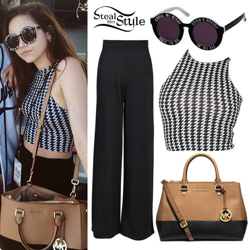 """Maggie Lindemann appeared at BeautyConLA yesterday wearing the House of Holland On A Promise Sunglasses (£150.00) which say """"cross my heart, hope to die, stick a needle in my eye,"""" the American Apparel Printed Cotton Spandex Jersey Sleeveless Crop Top ($26.00) in White Black Houndstooth, the tan and black colorblock Michael Kors Sutton Medium Saffiano Leather Satchel ($328.00, wrong color), and black pants similar to the Boohoo Sally Slinky Wide Leg High Waisted Trousers ($16.00). Get the…"""
