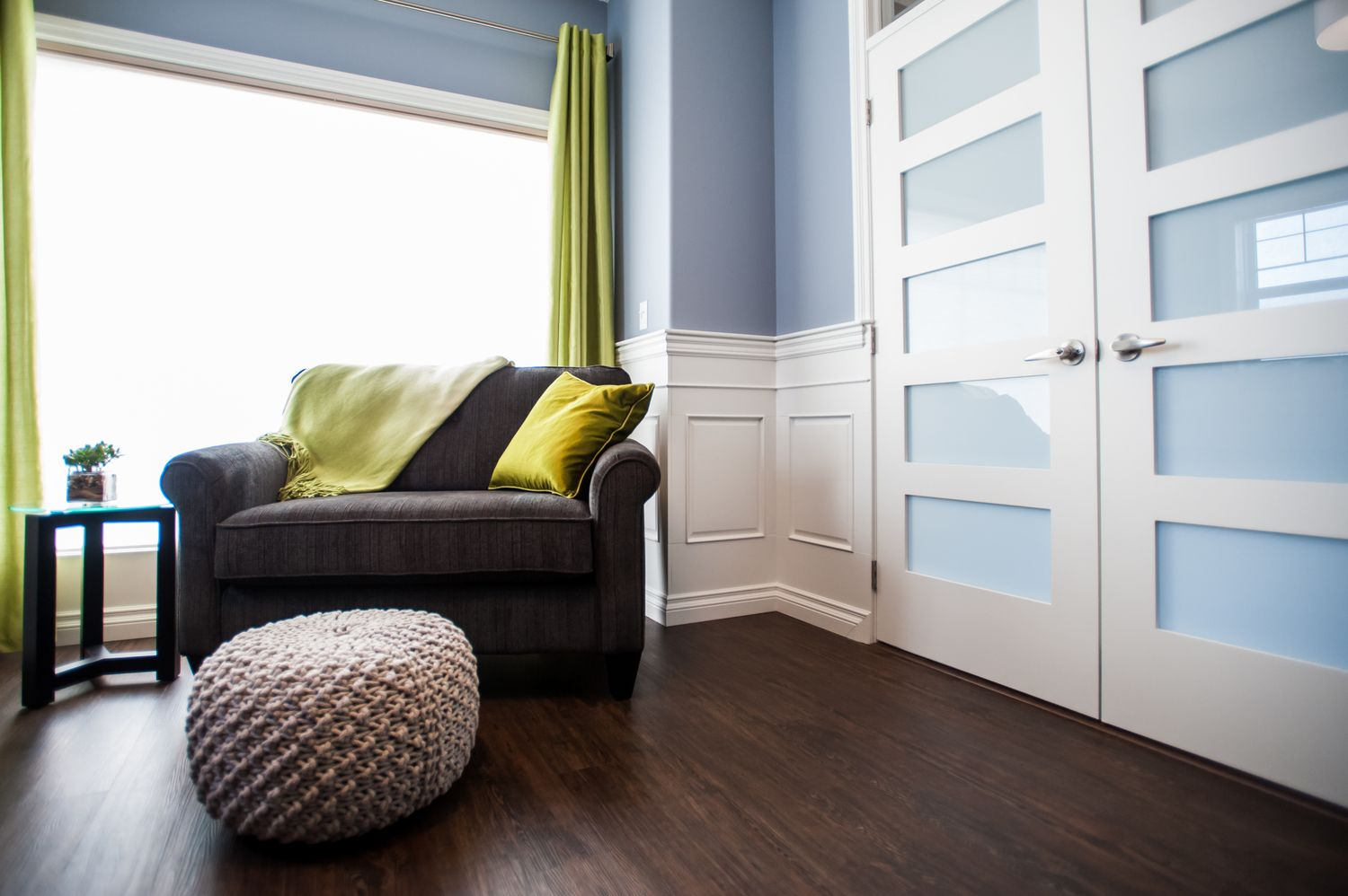 comfortable seating pouf chair and a half green blue white cork flooring french doors. Black Bedroom Furniture Sets. Home Design Ideas