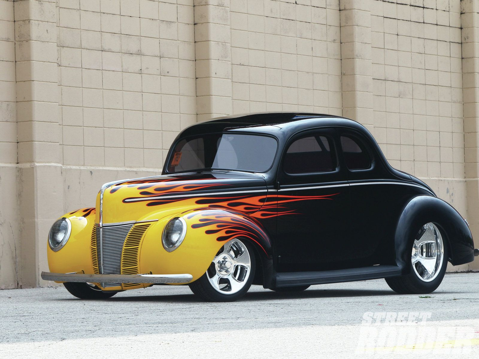 Larry olson doesn t limit his street rod preferences to the iconic 1940 ford coupe however this flamed custom ranks high on his list