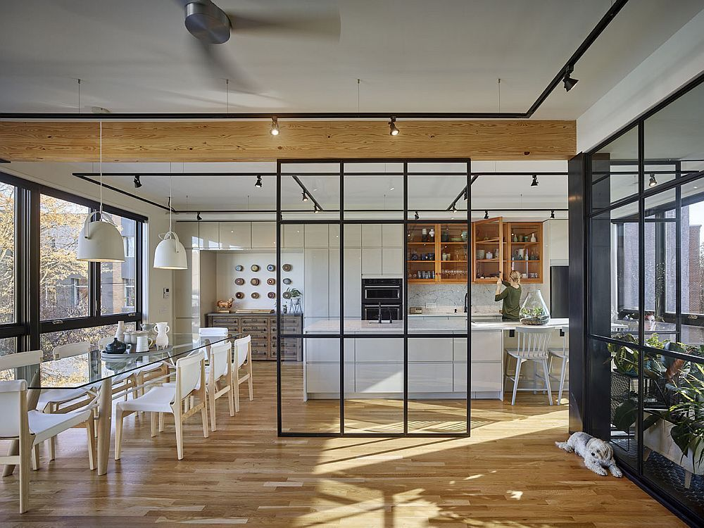 Smart glass walls and metallic frames delineate space