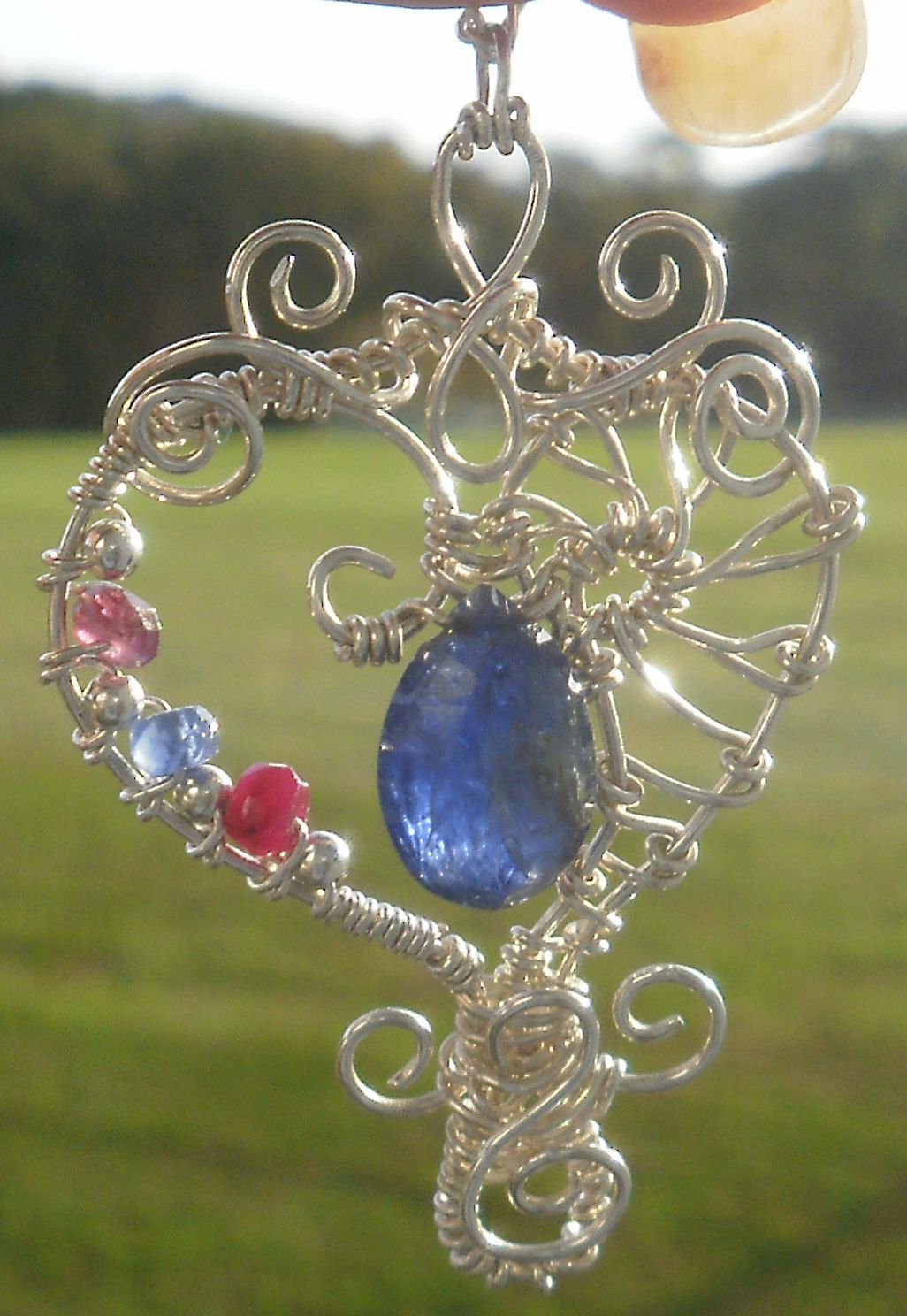 Custom Heart..... Sterling Silver, Sapphire, Ruby, and Garnet.... SOLD  ~ Designed by The Feathered Mane