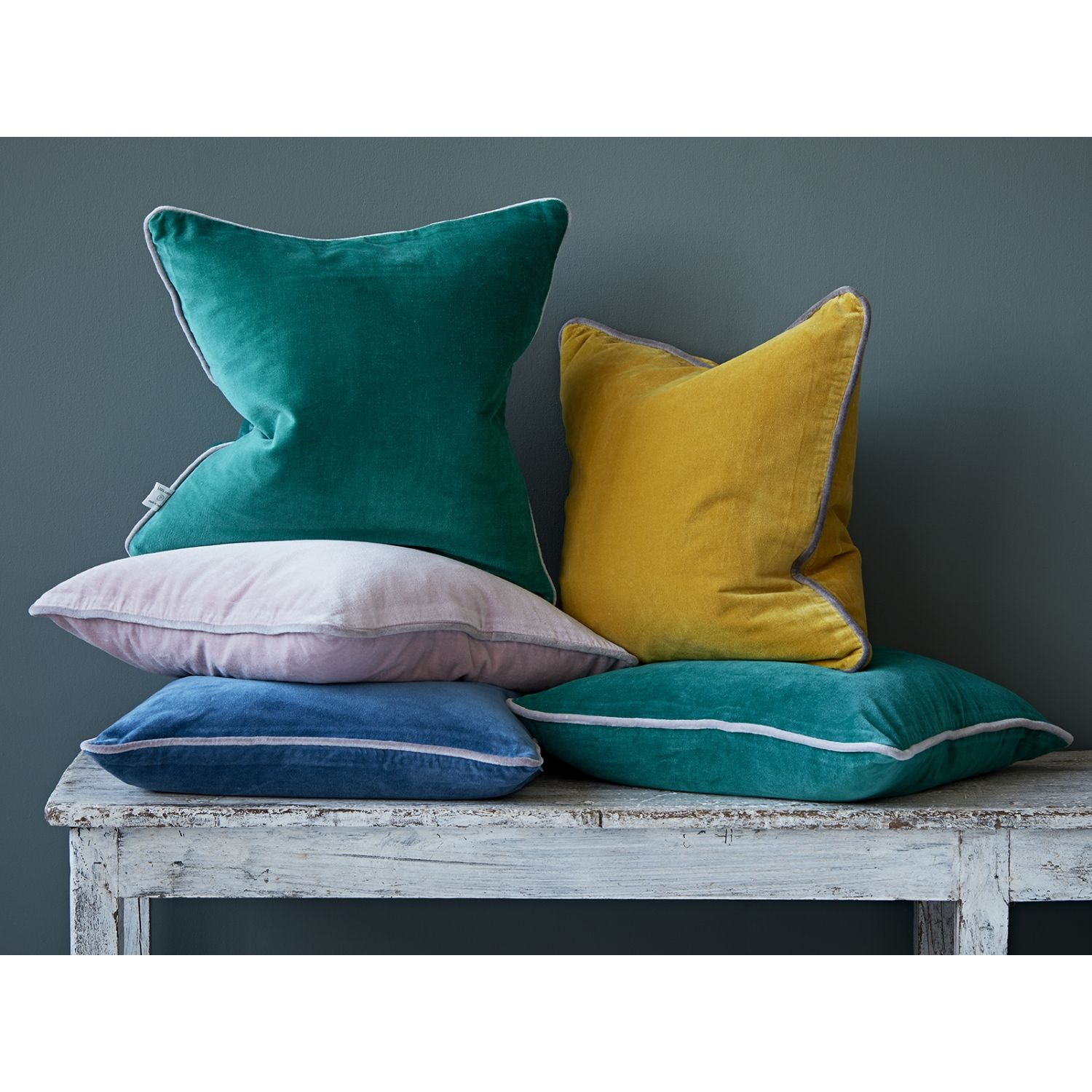 These lovely velvet cushions with contrast piping