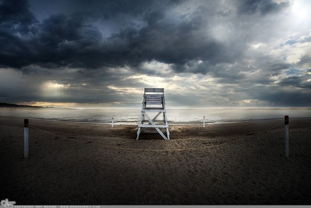 """Picture-A-Day (PAD n.2516) """"Notice""""  Caught this on my way home from a photoshoot out east. prints and more: http://www.dangrabbit.com/photography/pad/06_07_notice  Fineart photography dramatic clouds over lifeguard chair seascape - Long Island, New York"""