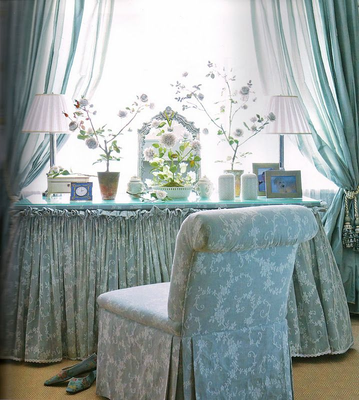 What woman would not love to have this skirted vanity and matching slipper chair in a beautiful soft blue? The table is arranged well & the tied back draperies bring in light & make a frame for this pretty space.
