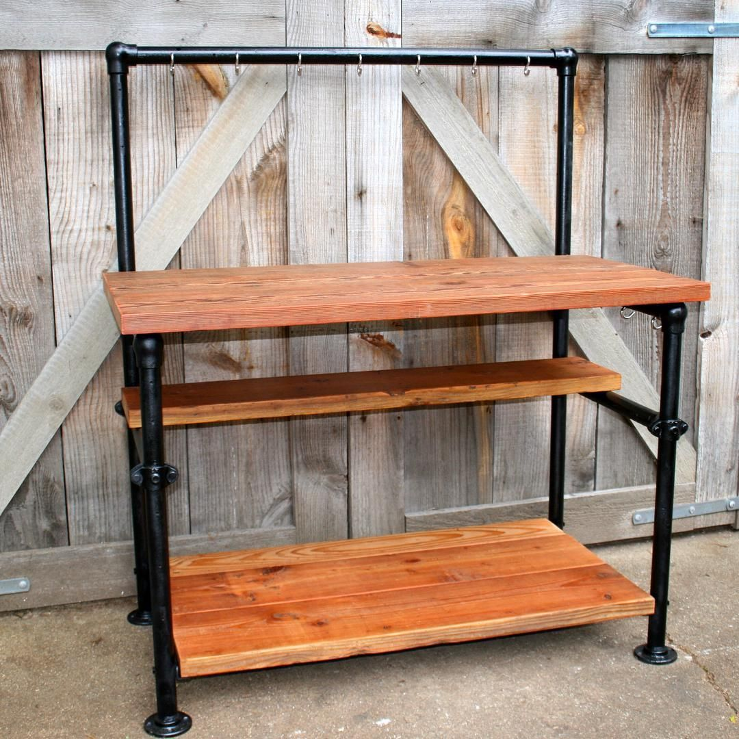 Old workbench converted into industrial style kitchen island/prep counter.