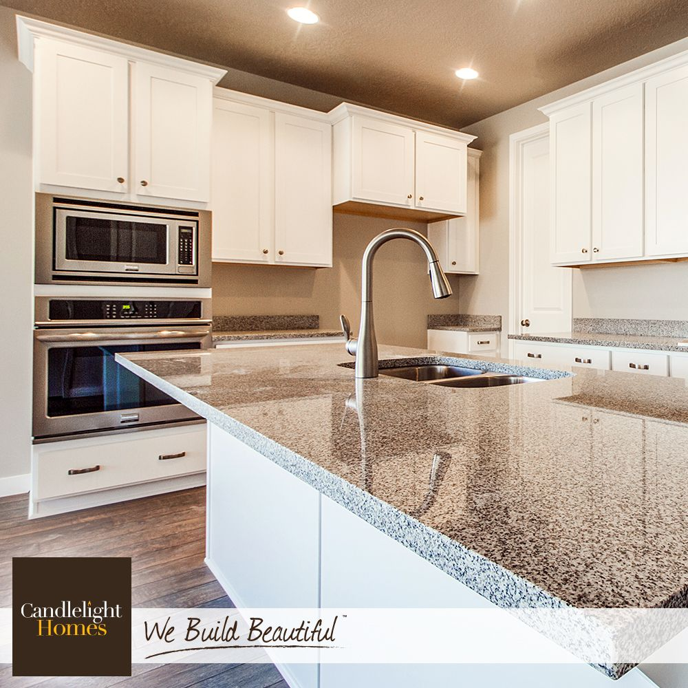 Salt Lake City Utah Houses: Shiny Quartz Countertops And Bright White Cabinets Reflect