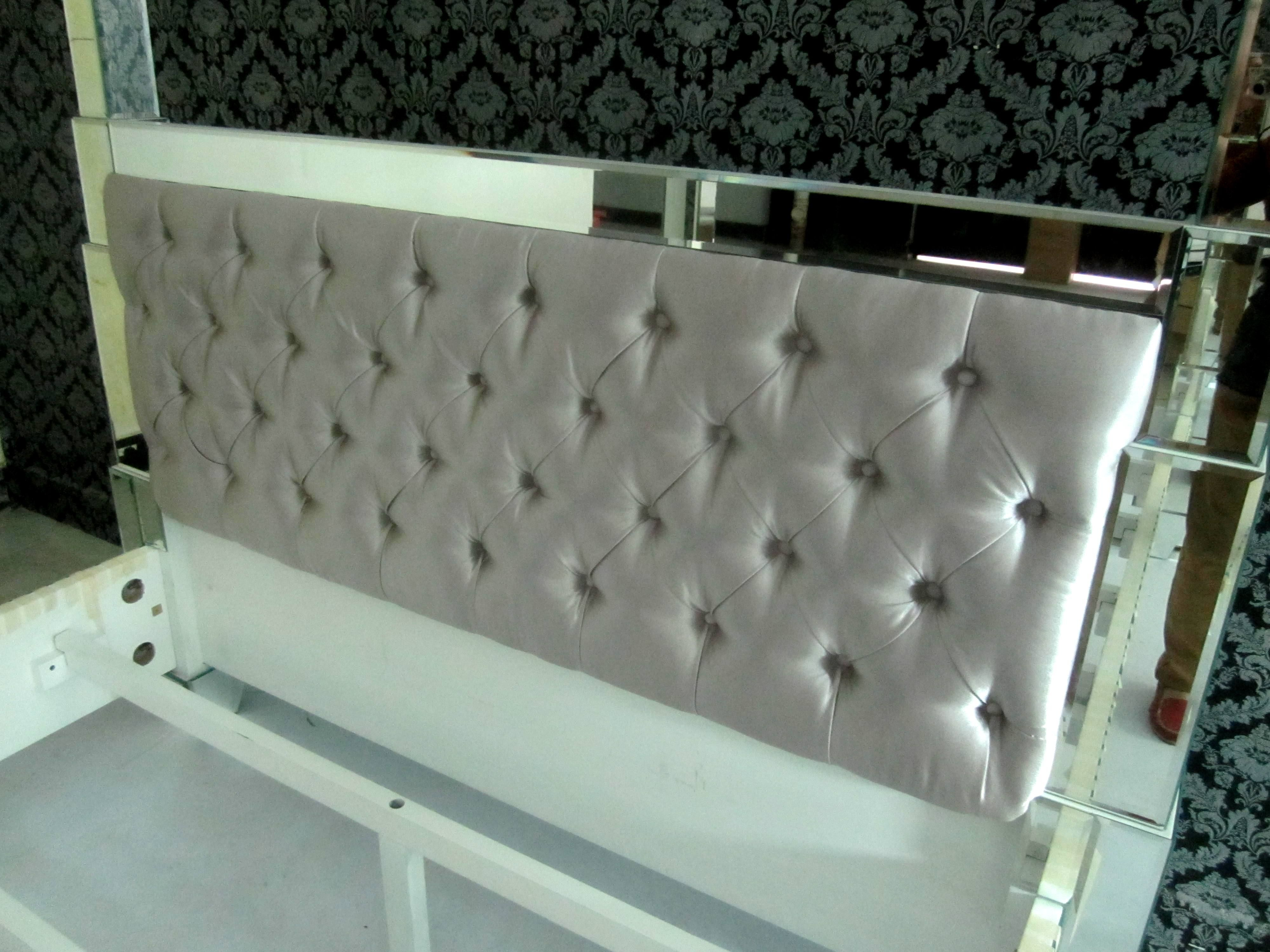 A Mirrored Prism Bed Being Made With Silver Tufted Velvet