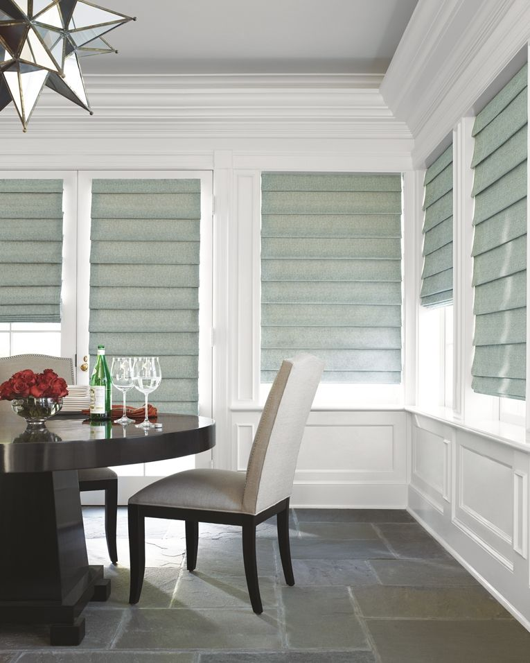 Hobbled Roman Shades   Soft Fabric Folds Cascade Across This Classic Style  Of Roman Shades For