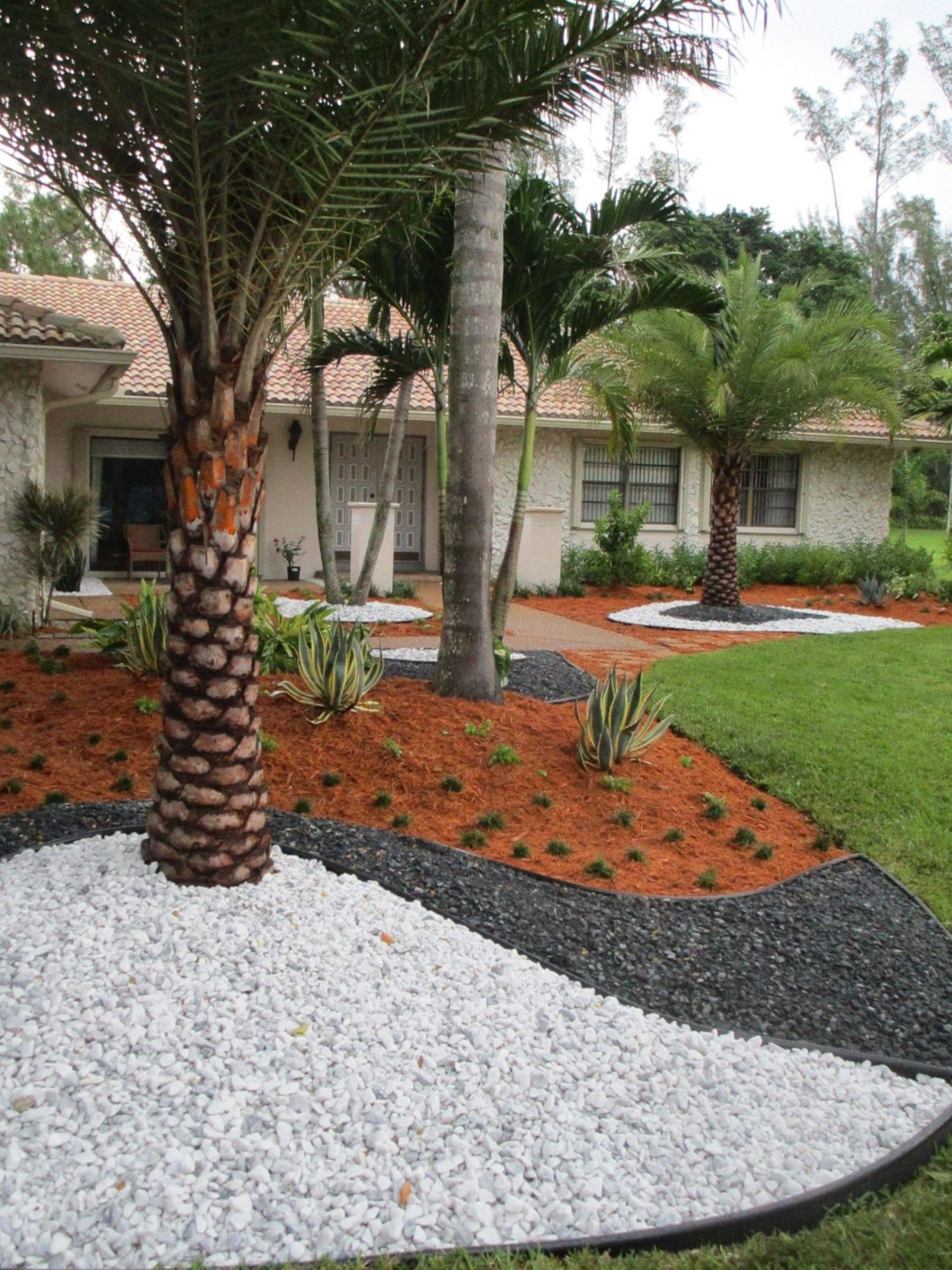 Excited Front Yard Landscaping Ideas With White Rocks Decor