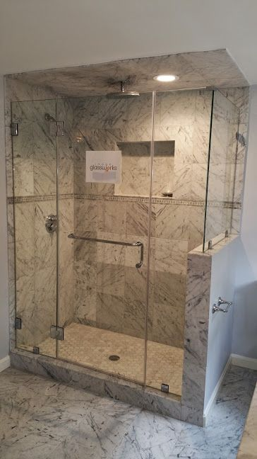 Frameless Shower Door With Chrome Hardware Towel Bar Handle