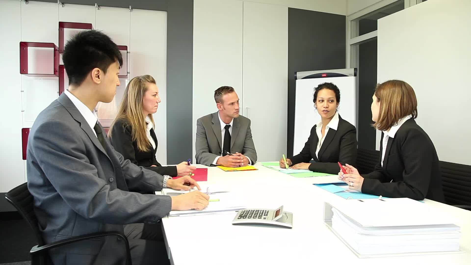 Five International People Having A Business Meeting In A