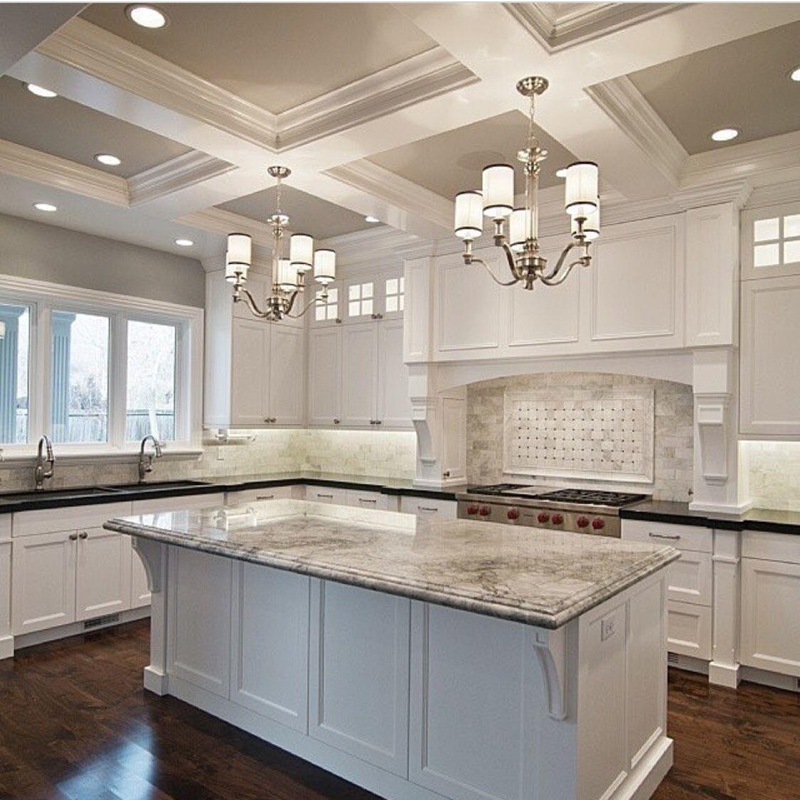 White Kitchen. Dark Floors. Large Island. Island Design