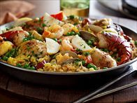 Get this all-star, easy-to-follow The Ultimate Paella recipe from Tyler Florence