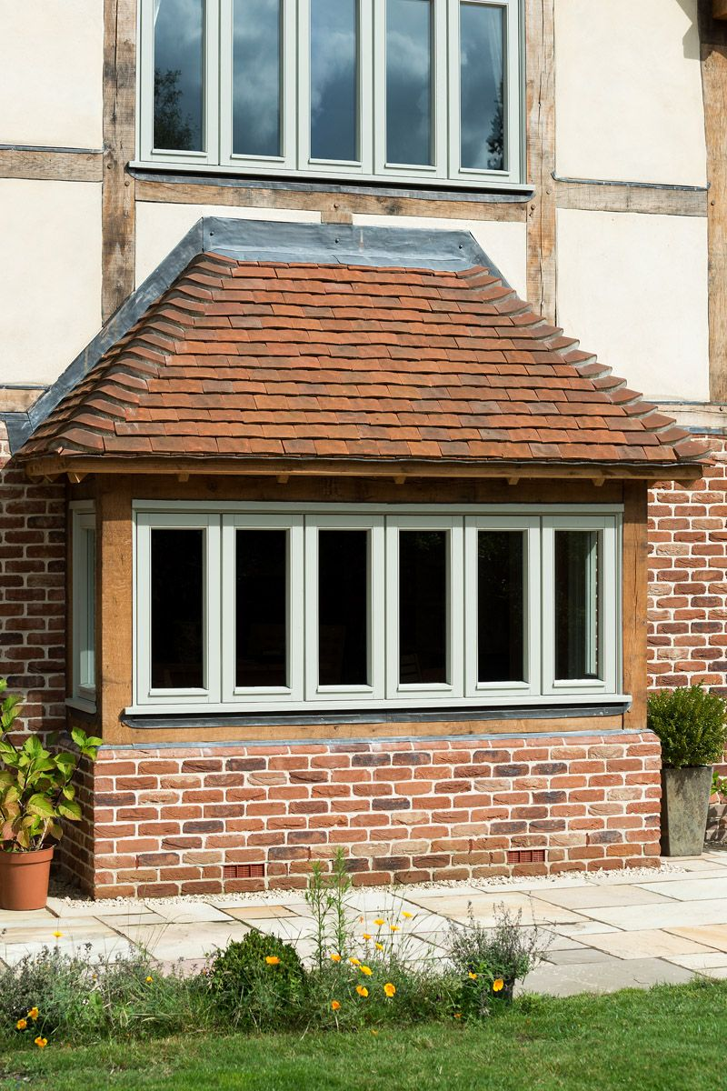 Bay Window With Handmade Clay Tile Roof Border Oak
