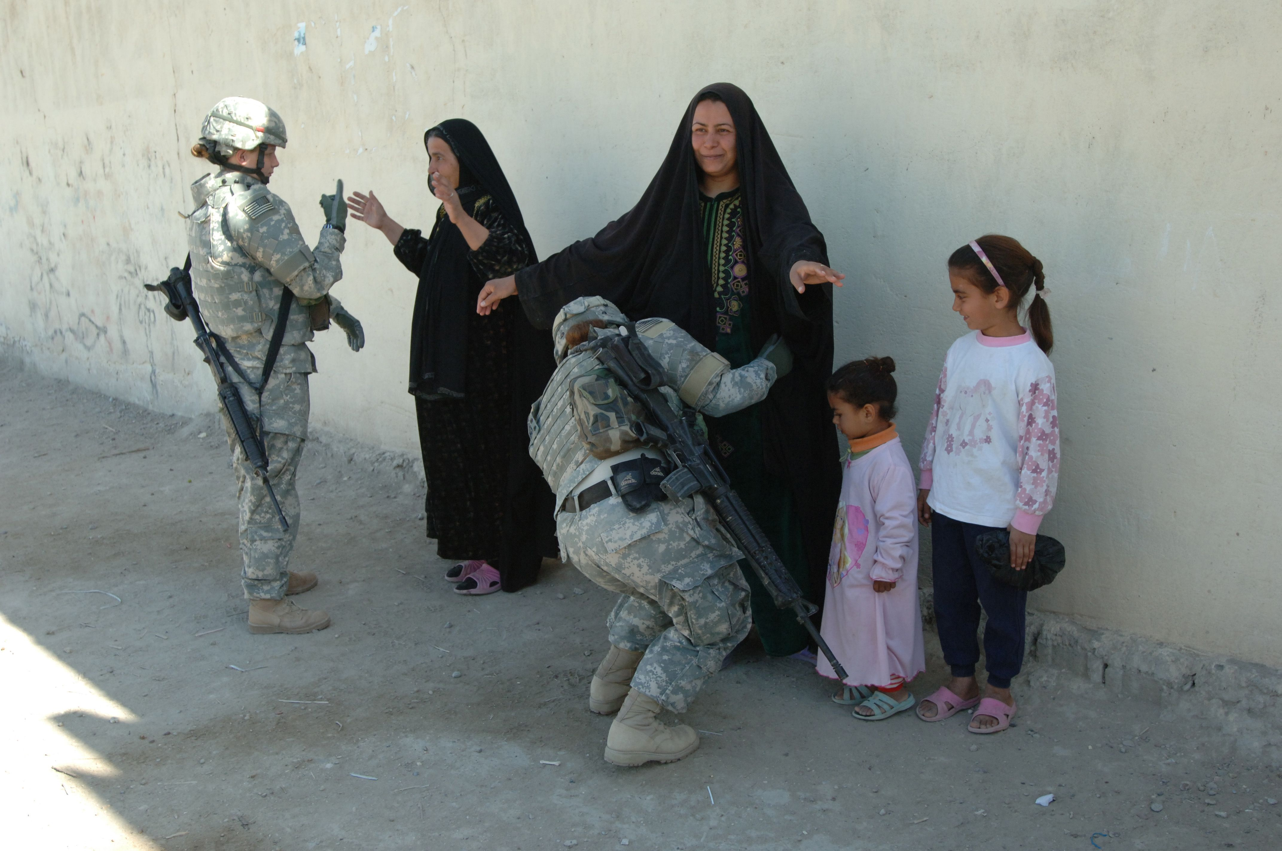 Two Female Us Army Soldiers Search Two Iraqi Women