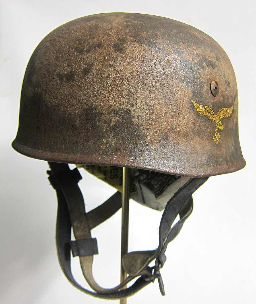 This is very good quality late war reproduction M38 Helmet