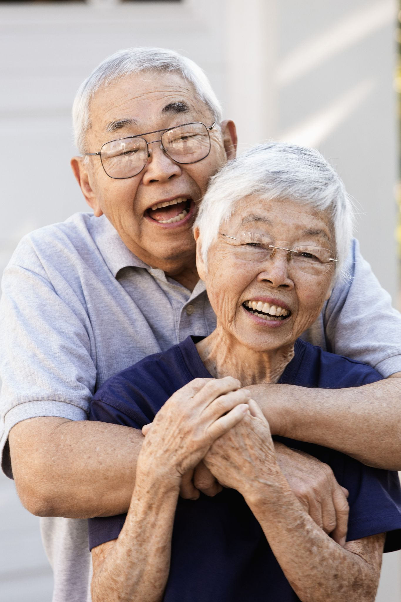 Older Asian Couple Hugging Outdoors By Gable Denims On 500px
