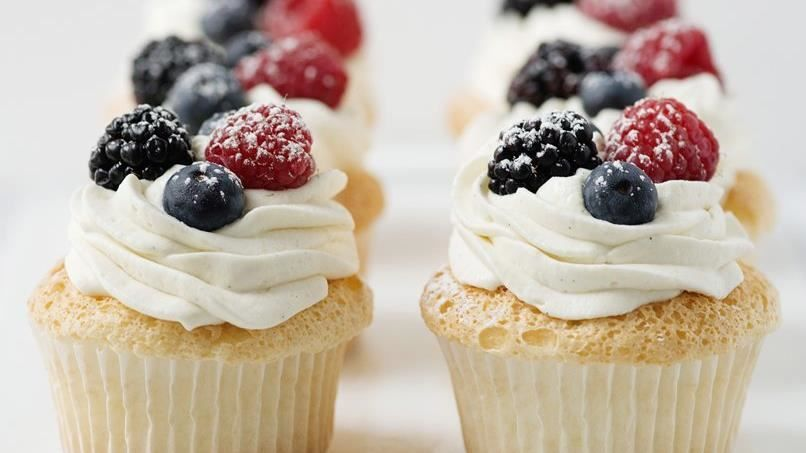 Set aside that cumbersome angel food cake pan and make this lighter-than-air dessert in cupcake form, instead.  Topped with vanilla bean whipped cream and fresh berries, this is a truly heavenly treat.
