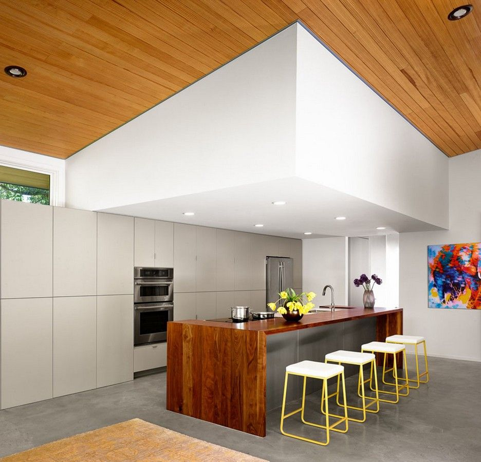 Contemporary Kitchen Design Ideas With Laminate Wood Waterfall Kitchen  Island And Yellow Barsstool Also Polished Concrete