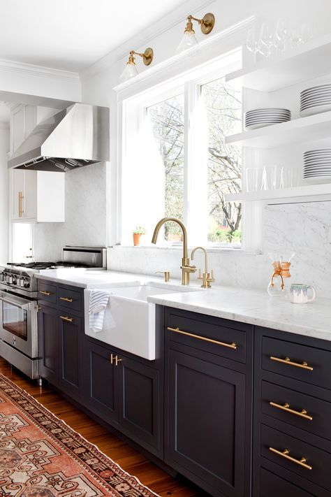 Modern Vintage Kitchen Modern vintage kitchen featuring black (very dark grey) lower cabinets,  antique gold tone hardware, pale gray and white granite countertops and  backsplash, ...