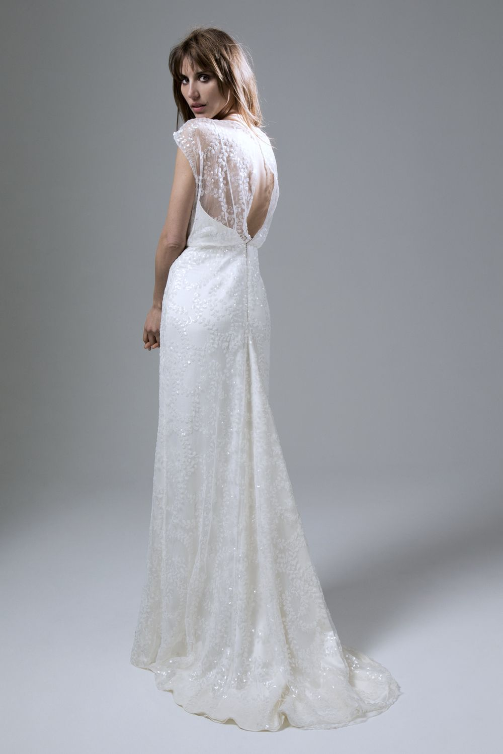ee633ca0 Back view of the Lydia sequin ivory slash neck dress with puddle train  wedding dress by