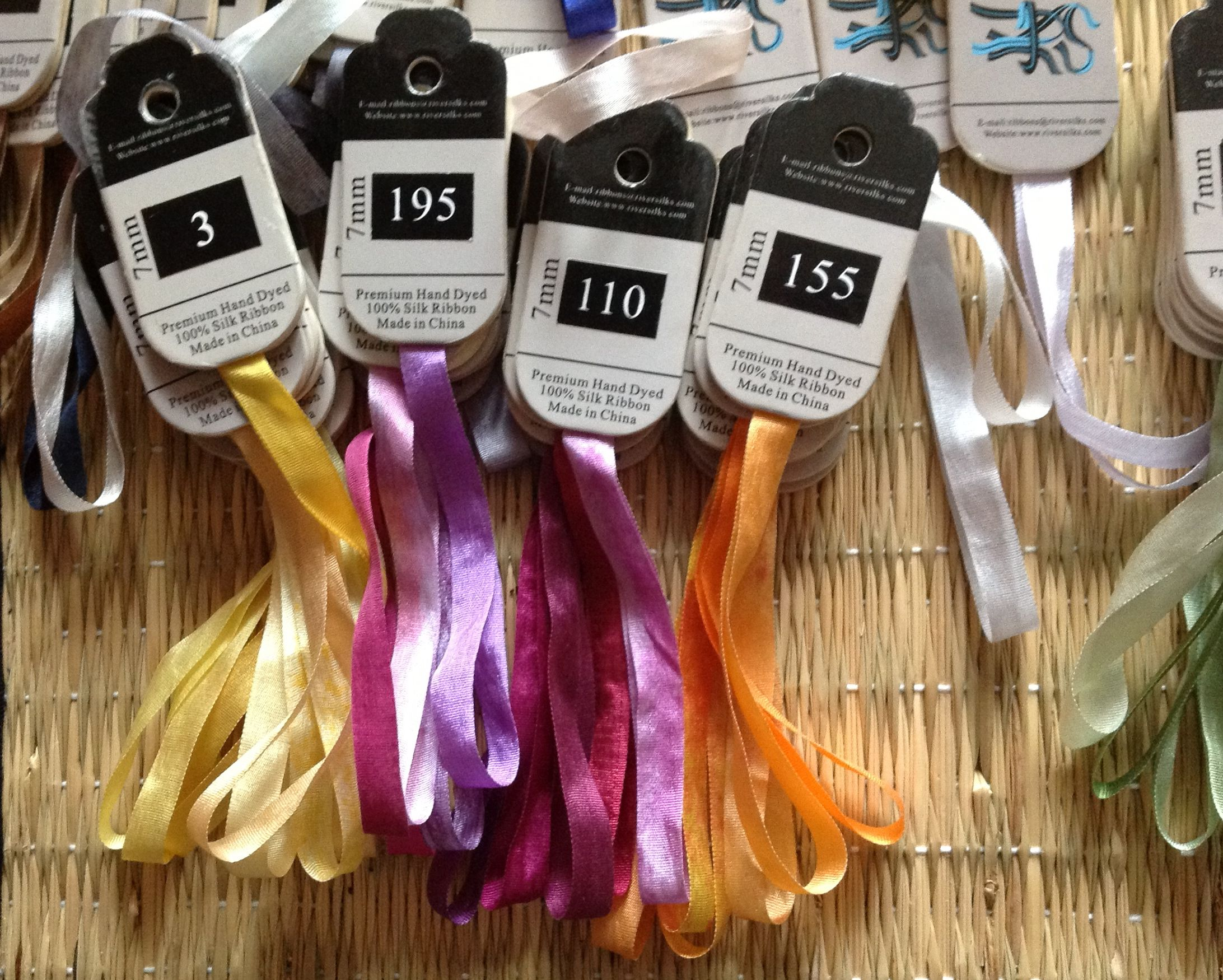 River Silks %100 silk ribbon, creating collections with cards from the color rings.