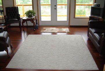 Medium Brown Living Room Hardwood Flooring With Cream Area Rug