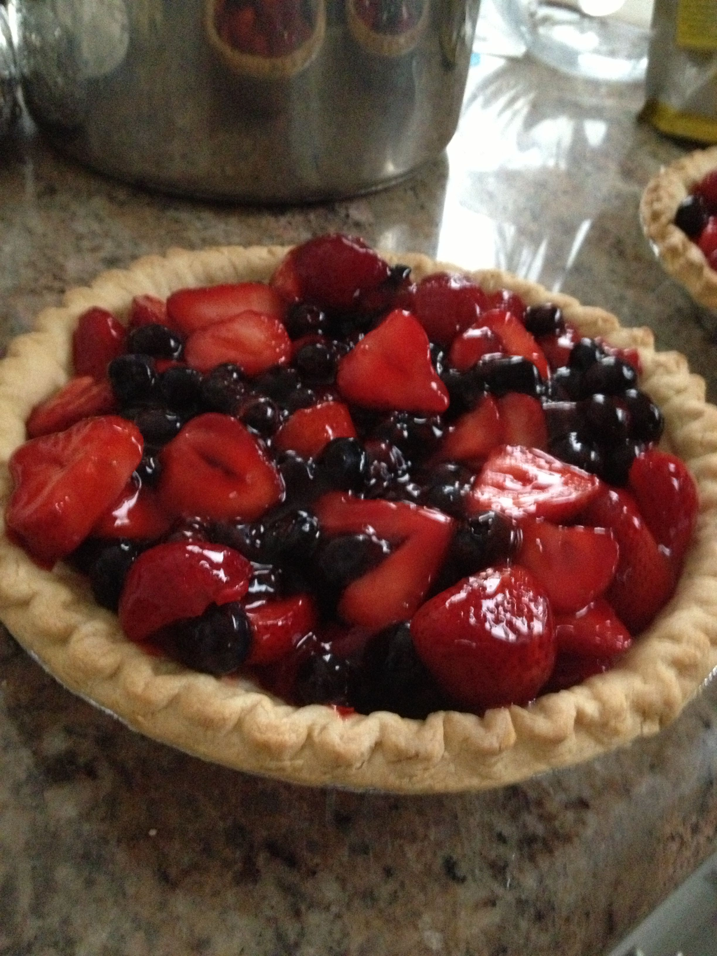 "4th of July food 3 pints of strawberries 2 pints of blueberries 1 pint of blackberries. Clean berries and mix in glaze. Bake 2 pies shells ""I use store-brand deep dish"". Let pie shells cool. Then put berry mixture into pie shells.Refrigerate for at least an hour then serve with whip cream."