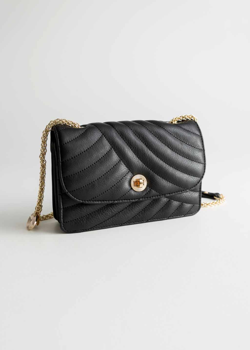 e946c48c34 Front image of Stories gold-tone chain small leather bag in black