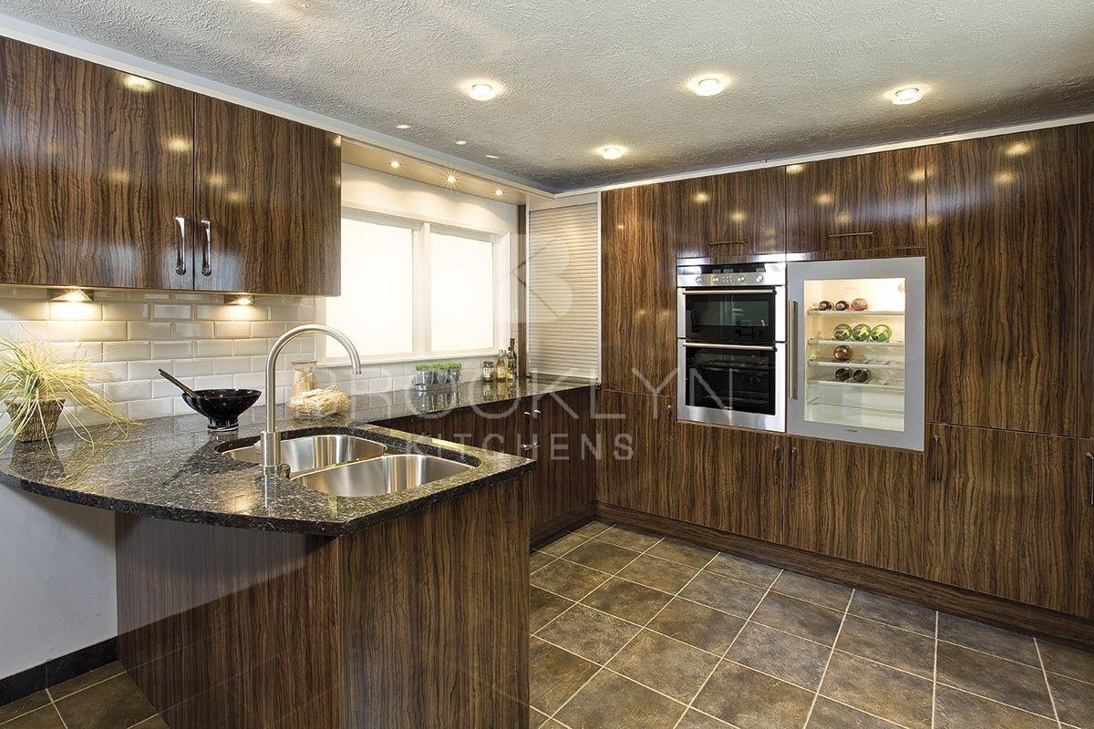 Stunning glossy wood effect fitted kitchen modern gloss wood