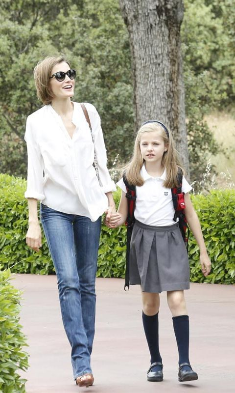 Queen Letizia shows off casual side in white blouse and ...