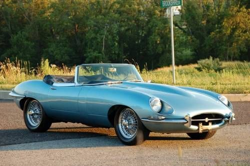 1967 Jaguar XKE Series.  It was black with red interier and f a s t.