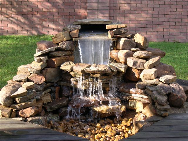 Building a garden pond waterfall pond waterfalls pumps for Diy small pond with waterfall